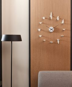 Birds in Motion Wall Clock | dotandbo.com    Idea to make my own?  with kids toys painted?
