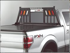 """Three Light Three Light Rack Frame only Lights not included 6 ¾"""" opening for the lights Truck specific hardware kit required Fits: Chev/GMC Classic/CK Series Nissan Titan Dodge Ram EXCLUDING Ram box Toyota Tundra 2007 Tundra, 2007 Toyota Tundra, Headache Rack Trucks, 2015 Nissan Titan, Tonneau Cover, Patio Pillows, Cool House Designs, Minimalist Design, Backyards"""