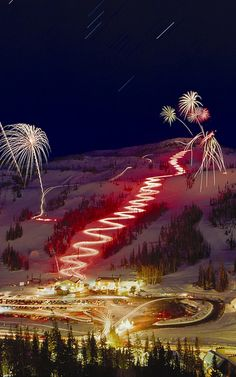 """A free Torchlight Parade and fireworks are served up each New Year's Eve at Brian Head Resort. The free New Year's Eve grand Torchlight Parade, featuring skiers and snowboarders gracefully gliding down the slopes, begins as darkness settles in on the 11,307 foot summit of Brian Head Peak and are followed by a spectacular fireworks display."" #SkiBrianHead"
