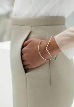 Fashion: New York City Style: Minimal jewelry - two silver bangles.