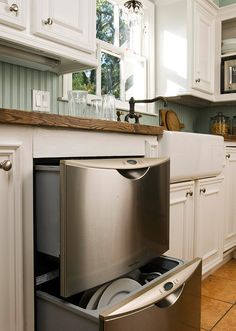 Showcase the Island Countertop - Green and white u-shaped kitchen
