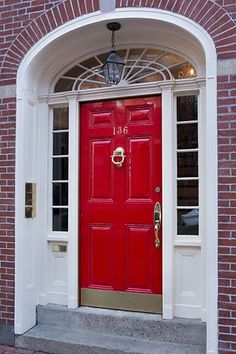 An eye-catching portal is coated in an elegant scarlet shade that really pops against the white trim and sidelights. @finepaintsofe Scarlet Sage