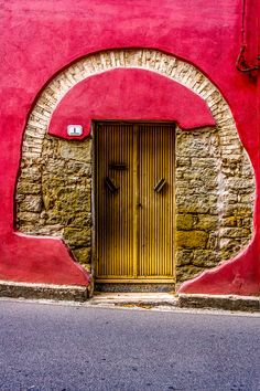 Doors - Bright textured doorway in Sardinia, Italy.