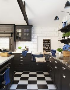 Industrial chic with black white checkerboard tile flooring, black cabinets, white subway tile backsplash