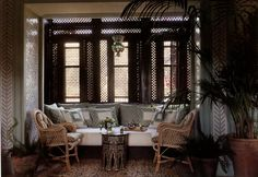 Marella Agnelli's house, Ain Kissimou, in Marrakech. The winter-garden room, walled with a treillage effect of green-and-white Fez tiles, suggests an Edwardian conservatory. Design by Alberto Pinto. Photo by Eric Boman.