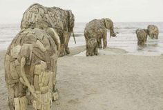 South African sculptor, Andries Botha constructed eight life sized elephants out of wood,and iron.The elephant were placed on the beach in De-Panne,Belgium. Elephant Love, Elephant Art, Wooden Elephant, Elephant Family, Elephant Sculpture, Sculpture Art, Land Art, Statues, Art Environnemental