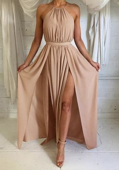 Lookbook Store // This nude M-slit halter dress is a remarkable floor-length number with partial lining and back less design with lace-up detailing.