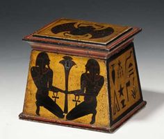 Regency period antique Tea Caddy - a rare and unusual container for tea in the shape of an Egyptian pylon surmounted by a cornice and decorated with Egyptian symbols on a gold background. English, early 19th century courtesy Martyn Cook Antiques, Redfern at Sydney - Maria Elena Garcia -  ► www.pinterest.com/megardel/ ◀︎