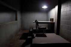 This is an interrogation scene that I am referencing for the set design as well as the lighting.