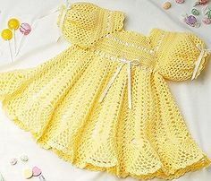 Banana Split Baby Dress Crochet ePattern - Number of Designs: 1 baby dress Approximate Design Size: Size 12 to 18 months Designer: C. Strohmeyer Original Publication: Leisure Arts Leaflet #2071, Dainty Dresses † Description: A swirly scalloped ruffle at the hem makes this pretty dress a delicious choice for baby. Crocheted using baby fingering weight yarn and size D and E hooks.†Product Type: Digital Download ThemesBabies & Children