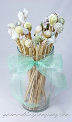 Adorned with natural seashells, these 10-inch tall swizzle sticks will bring a touch of the sea to your event. Great for luaus or tropical-themed weddings & parties where tall drinks are served. www.yourweddingcompany.com