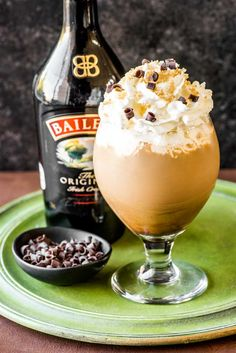 Irish Coffee! This fancy Irish coffee features all the best qualities of the traditional (such as dark brew coffee, Irish whiskey, and brown sugar) and takes it to the next level with a dash of Baileys, extra fluffy cream, chocolate shavings, and more brown sugar sprinkled on top. | HomemadeHooplah.com Kahlua Recipes, Irish Recipes, Coffee Recipes, Baileys Creme, Baileys Irish Cream, Irish Cream Coffee, Irish Coffee Recipe Baileys Jameson, Irish Whiskey, Coffee And Baileys
