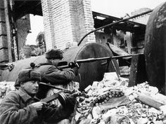 Russian anti-tank riflemen take position in the ruins of Stalingrad. The PTRD-41 anti-tank rifle delivered a ferocious kick to the firer. Note the guardsman in the foreground breaking his PPsH-41 SBG open to clear (?) a misfire. After the German Army captured large numbers of the PPSh-41s, a program was instituted to convert the weapon to the standard German submachine gun cartridge - 9mm Parabellum. The Wehrmacht officially adopted the converted PPSh-41 as the MP41(r).
