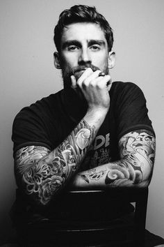 Black and white chair shot, focus on the tattoos brings this shot to life. | Guy Portrait Photography