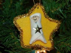 """Baby Jesus Ornament Star--use a heart as a background for """"Love Came Down at Christmas"""""""