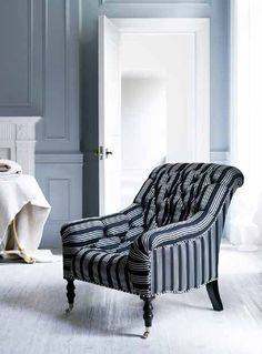 The Mayfair Tufted Chair in classic striped fabric from Ralph Lauren Home