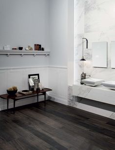 Wood effect of flooring with tiles: Wooden Tile of CDC #dark #wood #floor #bathroom #marble #wall