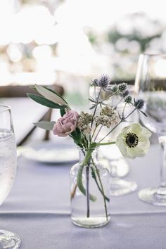 Bud vase centerpiece with anemone, carnation, olive, and thistle for a wedding with a lavender color scheme. Campovida wedding by Lily + Mint. Photo by Melissa Fuller Photography.