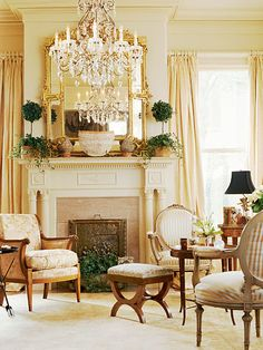 A pair of Louis XVI round-backed fauteuils and a Consulate bergere radiate high-toned elegance in this living room. .
