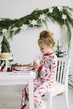 Dressed in Elf on the Shelf pajamas for the return of our scout elf! Love this Elf on the Shelf idea from @littlepeanutmag