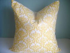 yellow pillow for blue chairs... lots of cute pillows on this Etsy site!  $35/each