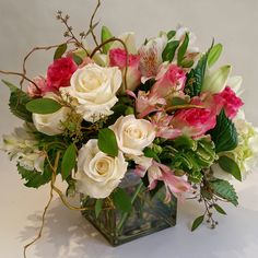 Short, compact and full of pinks and whites in roses, curly willow and more