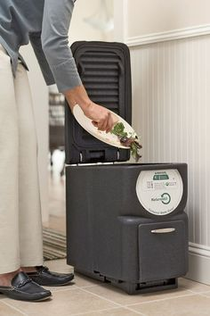 Deluxe Electric Kitchen Scrap Composter...too bad its 350 bucks! i really want this!