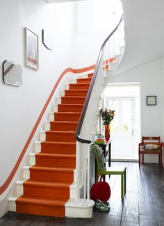 by London, U. The orange runner demands our attention, but it's the matching stripe of paint tracing the stairway's sweeping curve that sets these stairs design interior design house design home design Paint Runner, Houses Architecture, Classical Architecture, Interior Architecture, Orange Rooms, Color Of The Day, Painted Stairs, Painted Staircases, Boho Home