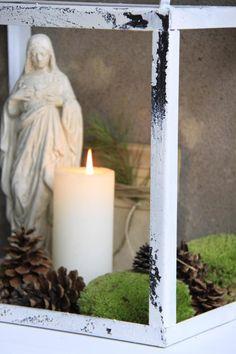 moss, pinecones, candle via Jeanne d'Arc Living magazine