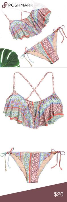 Ruffle flounce tie patterned bikini A flirty ruffle brings a flattering look to this H&M bikini. In a floral pattern design using pastel shades. The top and bottom are different sizes but with the adjustability of the tie sides on the bottoms and bikini top tie fasten they can easily be paired. Happy to answer questions, thank you for looking. H&M Swim Bikinis