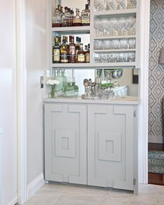 Even in the narrowest spaces, there's always a way to get creative with storage solutions. In our dining room, we turned a wasted corner into a built-in bar area for entertaining and glassware storage. The upper cabinets are just 11 inches deep, while the base cabinet is 14 inches deep. To make the piece appear more substantial, we added a mirror on the wall before adding shelving. Now that the bar is in place, the items in our kitchen cabinets have much more room to breathe. (Want to try a…