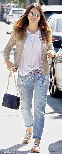 She can't blame this on Silas: On Thursday the 34-year-old actress said she'd put all her 'nice outfits away' and that certainly appeared to be true when she turned up in paint-splattered ripped jeans and a T-shirt for breakfast with a pal in Los Angeles