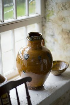 large round jug with applied medallions — Oxford Ceramics