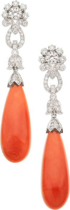Coral, Diamond, White Gold Earrings The earrings feature teardrop-shaped coral cabochons, surmounted by full-cut - Available at 2012 December 3 Jewelry. Coral Jewelry, Bling Jewelry, Antique Jewelry, Vintage Jewelry, Bijoux Art Deco, Ring Verlobung, Diamond Are A Girls Best Friend, Diamond Cuts, Diamond Earrings