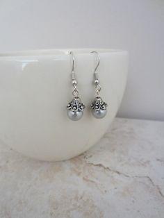 Grey pearl earrings, so classic.
