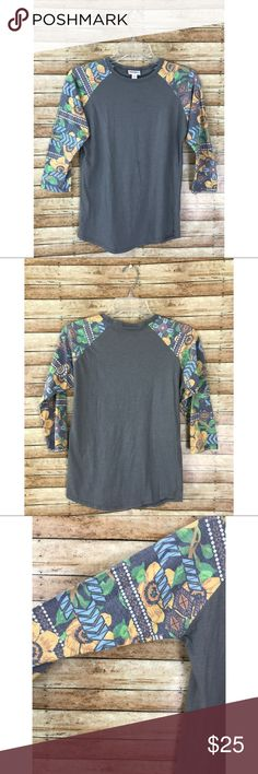 "LuLaRoe Gray Hawaiian Floral Randy T-Shirt LuLaRoe Gray Hawaiian Floral Randy T-Shirt. Light piling from wear.  comes from a smoke free, pet friendly home. NO TRADES!  Measurements: -Armpit to Armpit: 17"" -Top To Bottom: 25"" -Armpit To Bottom: 15"" LuLaRoe Tops Tees - Short Sleeve"