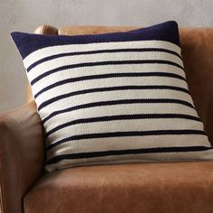 "Shop division navy 20"" pillow.   Upcycled yarn spins a fresh color story in a nubby, earthy weave of navy/natural stripes.  Wide navy border on one end keeps things unpredictable.  Cotton/acrylic pillow flips to 100% cotton in natural."