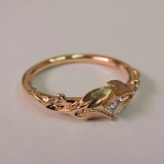 https://www.etsy.com/listing/213821887/leaves-engagement-ring-14k-rose-gold-and?ref=br_feed_3