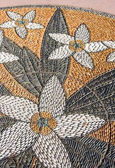 Pebble mosaic white flowers like ubud