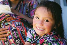 Look at that smile! This little #girl from #Guatemala is wearing the traditional #dress of the Mayan people.