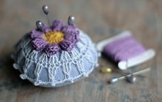 Awesome pincushion pattern, NO pattern. But doing a flower, then attaching can be easy if you creative! I adore this as a cushion. Pinning for me to inspire, charm and ogle over... ahhh xox