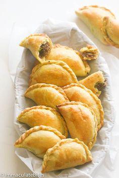 Jamaican Meat Pie Jamaican Beef Patty, empanada, or hand pie Jamaican Meat Pies, Jamaican Beef Patties, Jamaican Dishes, Jamaican Recipes, Curry Recipes, Pie Recipes, Mexican Food Recipes, Cooking Recipes, Jamaican Patty