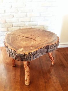 This unique coffee table, ''Les Jumeaux'' (The Twins) is made from ash tree, 25'' in diameter, on 4 legs of birch, 3 coats of varnish. The name ''Les