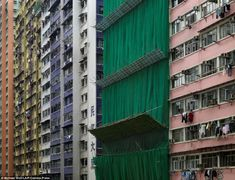 Over-population: These photographs of Hong Kongs apartment buildings appear to reflect a city bursting at the seams