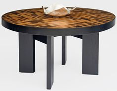 Reclaimed wood is utilized in a soft modern dining table design.  Custom sizes are available.