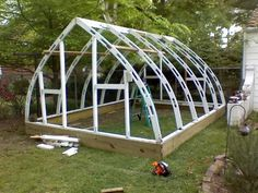 Hi all, I'm back from a looong vacation from this forum. I have just finished my 12x18 gothic arch wood frame greenhouse. A friend of mine and I found it totally by chance at a plant show this spring...for $350. We purchased it and have been working on setting it up ever since. It's a painted wood f...