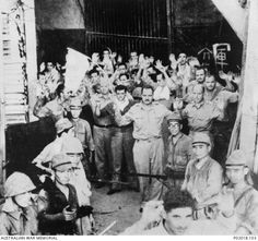 Corregidor, Philippine Islands. 1942-05. American defenders of Corregidor being herded by Japanese soldiers out of the fortress tunnels where they had been besieged for twenty eight days.