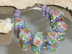 KALYPSO  FLOWERZ lampwork beads 6 rounds plus by Flameartbytd