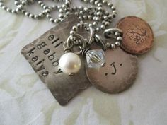 Rustic Sterling Silver and Copper Hand Stamped Family Charm Necklace. $52.00, via Etsy.