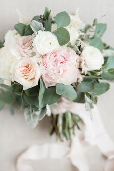 peony, ranunculus, eucalyptus greenery, blush silk ribbon streamers, dusty miller